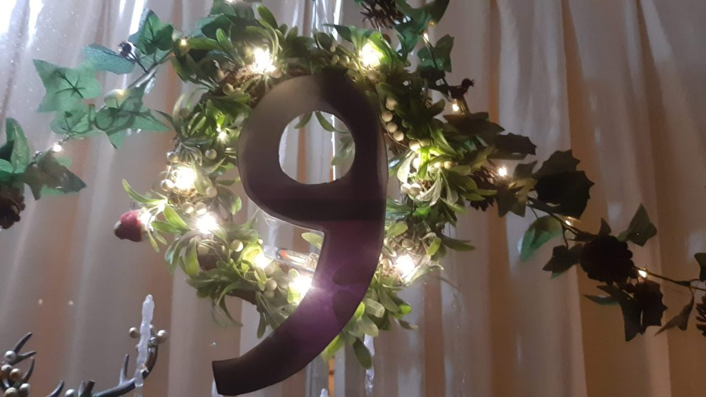 Number 9 lit up with fairy lights