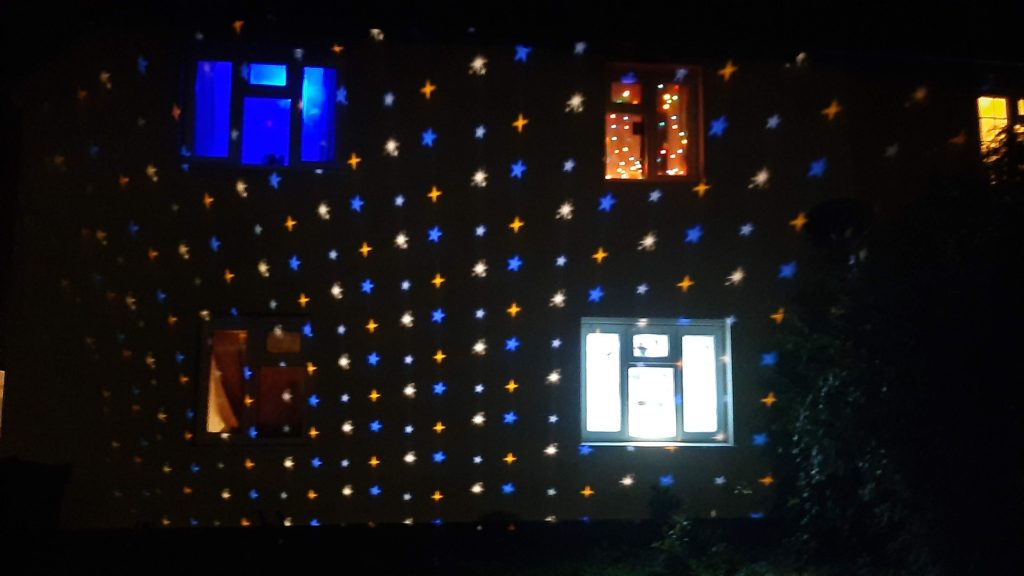 Projected stars on the house